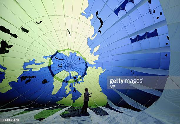 A Greenpeace activist checks the hot air ballon before placing it in the Kukulkan Castle on the archeology zone Chichen Itza in Yucatan Mexico on...