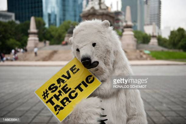 A Greenpeace activist fancy dressed as a polar bear participates in a protest against oil exploitation and industrial fishing in the Artic in Mexico...