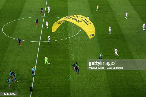 Greenpeace activist lands on the pitch the UEFA Euro 2020 Championship Group F match between France and Germany at Allianz Arena on June 15, 2021 in...