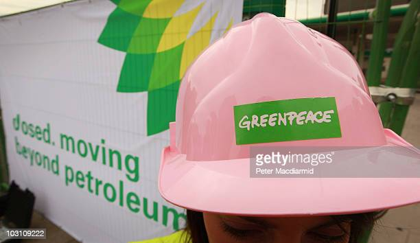 Greenpeace activist stands outside a closed BP petrol station in Camden on July 27 2010 in London England Greenpeace say that they have shut down...