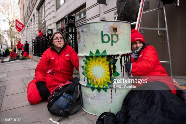 Greenpeace activists attempt to blockade the BP headquarters with solar panels, boards and activists locking themselves to oil drums on February 5,...