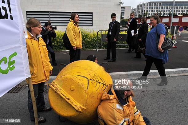 Greenpeace activists block the access to the Council building in Luxembourg during an Agriculture fisheries and food council on June 12 2012 The...