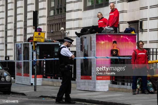 Greenpeace activists blockade all entrances to the BP headquarters in London demanding an end to all new oil and gas exploration on May 20 2019 in...