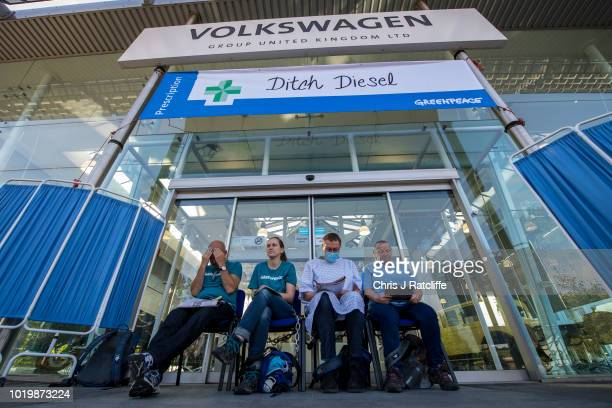 Greenpeace activists chain themselves to an entrance at Volkswagen United Kingdom Headquarters as they campaign to highlight the country's air...