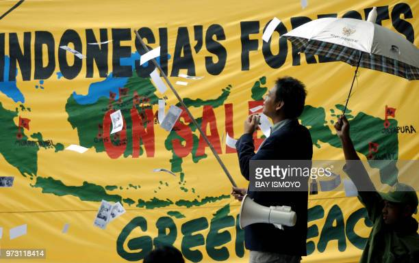 Greenpeace activists conduct a mock auction for Indonesian forests during a protest in front of the Forestry Ministry in Jakarta 24 January 2007...