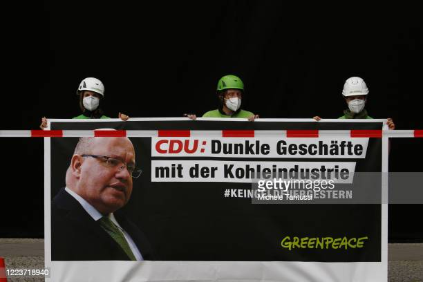 Greenpeace activists cover the CDU Headquarters Konrad Adenauer Haus with Black fabric and hold a Banner showing the Economy and Energy Minister...