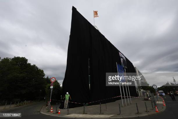 Greenpeace activists cover the CDU Headquarters Konrad Adenauer Haus with Black fabric during a Protest against the coal Exit strategy of the German...