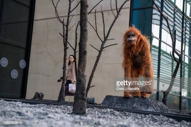 Greenpeace activists create a burnt smoldering rainforest with a lifelike animatronic orangutan at the headquarters of Oreo cookies in protest over...