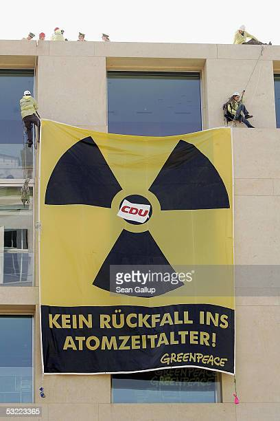 Greenpeace activists demonstrate with signs that read No Fallback into the Atomic Era outside the building where the leadership of the opposition...