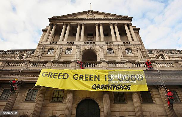Greenpeace activists drape a banner from The Bank of England on November 24 2008 in The City of London Later the Chancellor of the Exchequer will...