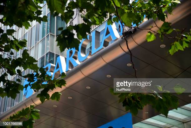 Greenpeace activists gather at the main entrance of Barclays bank hedquarters in Canary Wharf in protest over the bank's refusal to stop funding...
