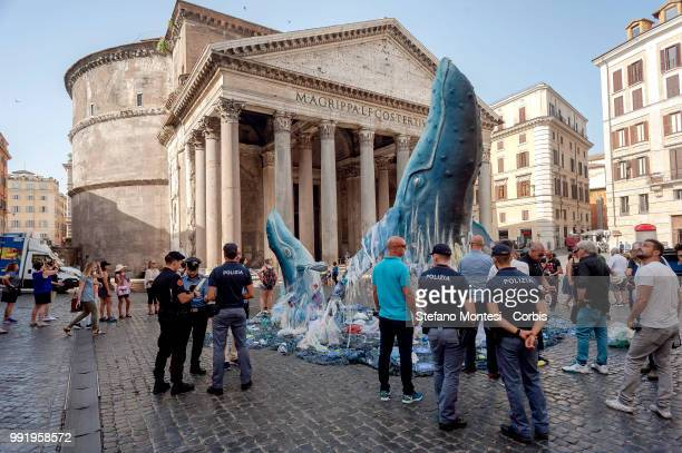 Greenpeace activists have assembled two lifesize reproductions of two whales respectively 6 and 3 metres high that emerge from a sea invaded by...