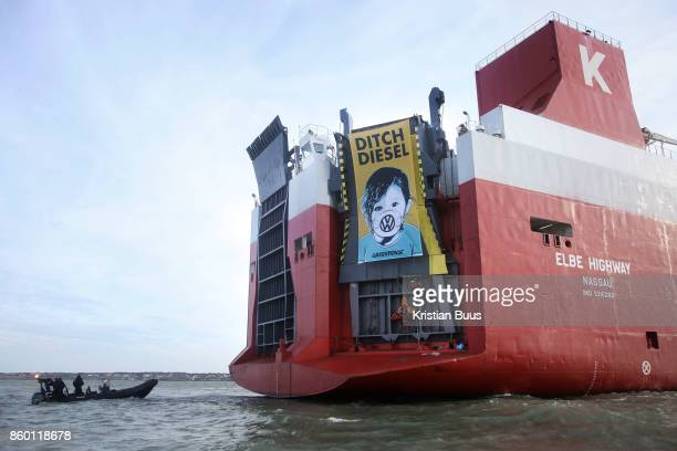 Greenpeace activists have deployed a banner calling VW to ditch dielsel on the back of the cargo ship September 21st 2017 Thames Estuary Kent United...