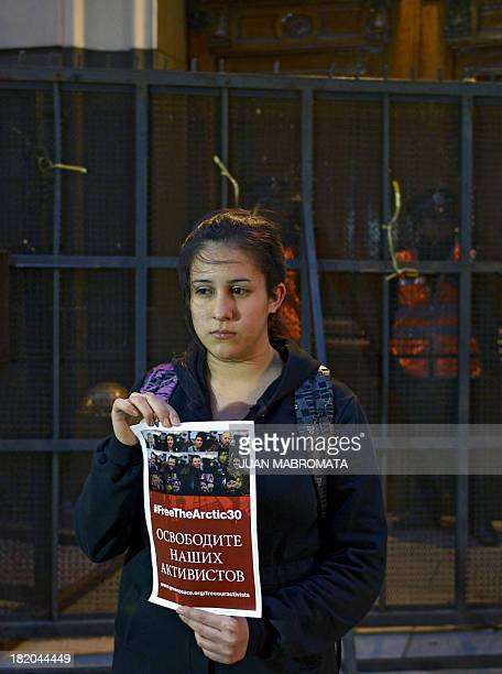 Greenpeace activists hold a protest on September 27 2013 in front of the Russian embassy in Buenos Aires demanding the release of activists from...