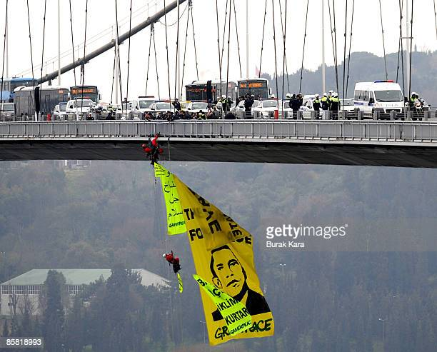 Greenpeace activists open a banner of US President Barack Obam on Bosphorus Bridge during a protest against Obama's visit on April 6 2009 in Istanbul...