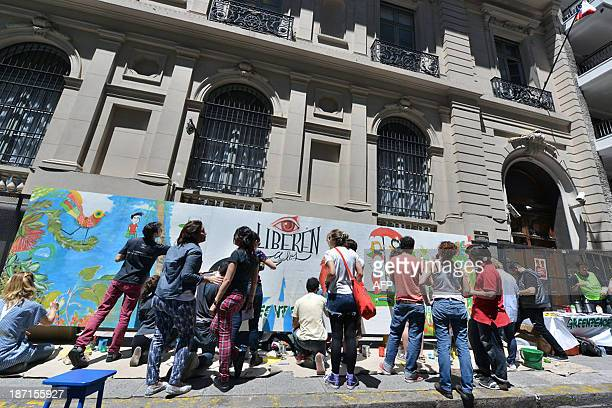 Greenpeace activists paint a mural in front of the Russian embassy in Buenos Aires on November 6 claiming for the release of 30 activists from...