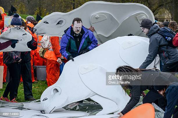 Greenpeace activists prepare their polar bear cut outs at the bottom of Park Lane next to Wellington Arch during the London Climate March as part of...