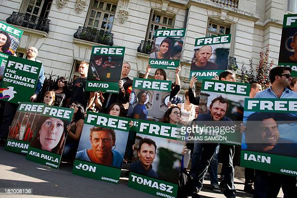 Greenpeace activists protest on September 27 2013 in front of the Russian embassy in Paris with signs calling for the release of activists from...