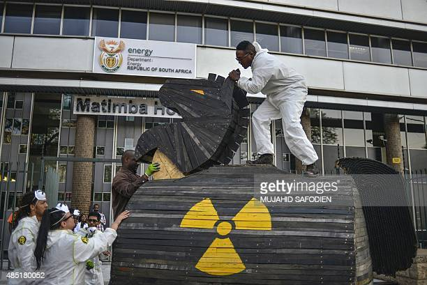 Greenpeace activists set up a mock Trojan horse they built and chained to the front gate of the South African Department of Energy's building as part...