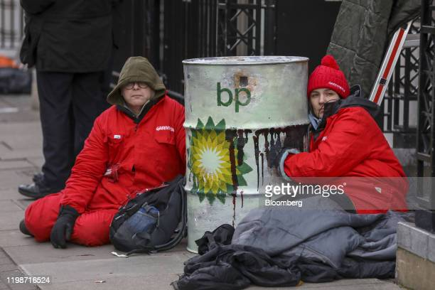 Greenpeace activists sit chained to an oil drum during a protest outside the BP Plc headquarters in London, U.K., on Wednesday, Feb. 5, 2020. Bernard...