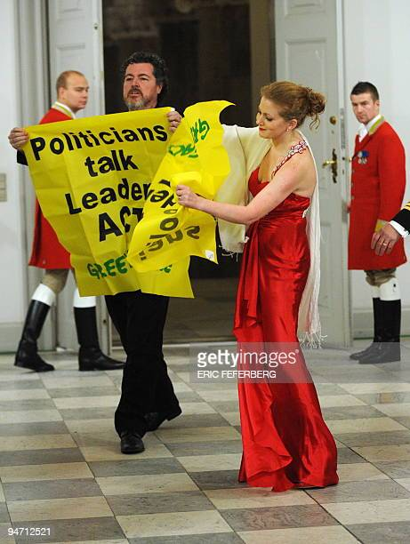Greenpeace activists unfold a banner distrurbing the arrival of heads of states for the official dinner hosted by Denmark's Queen Margrethe II in...