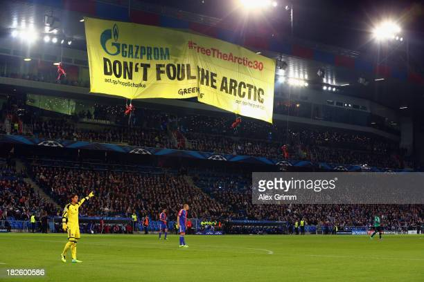 Greenpeace activists unveil a banner during the UEFA Champions League Group E match between FC Basel 1893 and FC Schalke 04 at St. Jakob-Park on...
