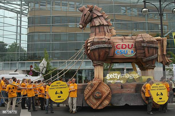 Greenpeace activists with a giant Trojan horse protest the nuclear energy policy of German Chancellor and head of the German Christian Democrats...