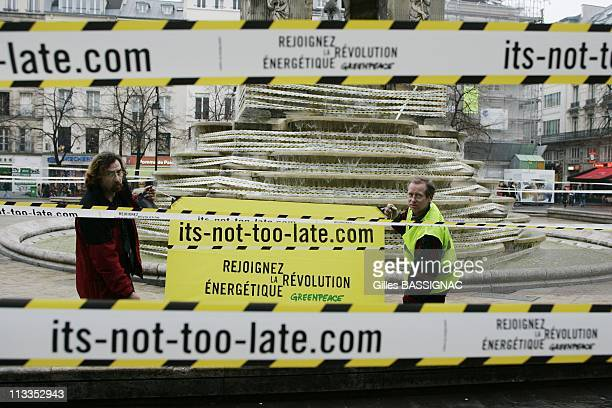 Greenpeace Activists Wrap The Fontaine Des Innocents In Les Halles To Attract Public Attention On The Climate Changes In Paris France On February 02...