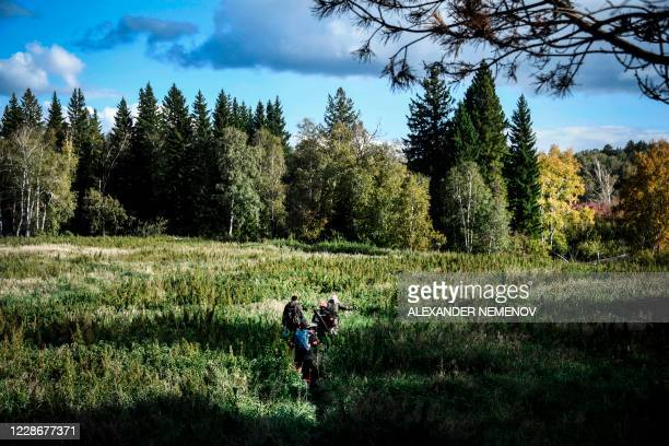 Greenpeace and local activists make their way through a Suzunsky forest next to the village of Shipunovo 170 kms south from Siberian city of...