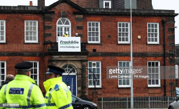 Greenpeace campaigners occupy the local Conservative club in George Osborne's Tatton constituency as they protest against fracking the controversial...