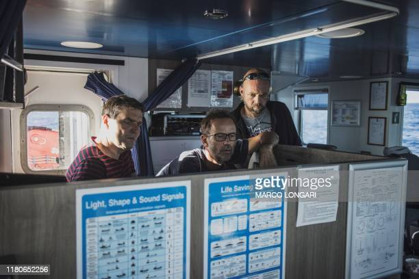 Greenpeace Chief Campaigner Thilo Maack Arctic Sunrise captain Mike Finchen and Actions Coordinator Timo Liebe are seen on the bridge of the...