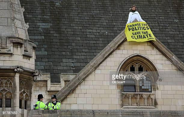 Greenpeace climate change protesters wave banners from the roof of the Houses of Parliament on October 12 2009 in London England Approximately 20...