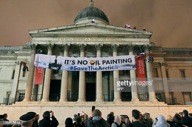 Greenpeace protesters scale the pillars of the National Gallery in central London on February 21 as they unfurl a banner in protest at oil firm...