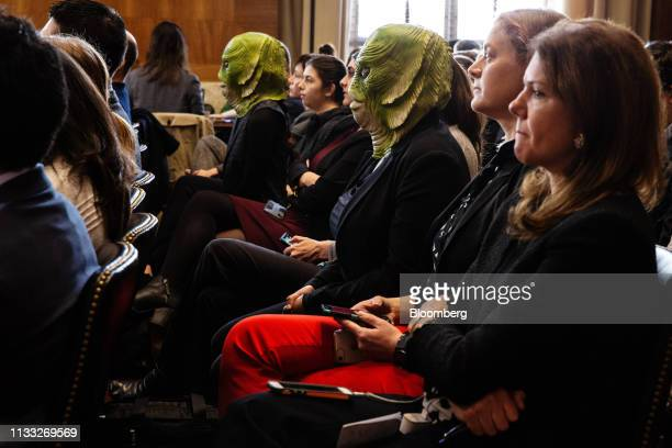 Greenpeace protesters wearing masks listen during a confirmation hearing for David Bernhardt US secretary of interior nominee for US President Donald...