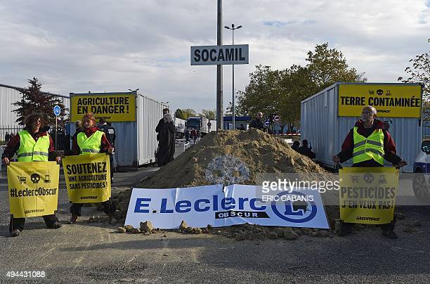 Greenpeace protestors block the entrance to a Leclerc supply depot in Tournefeuille near Toulouse on October 27 2015 Greenpeace on October 27...