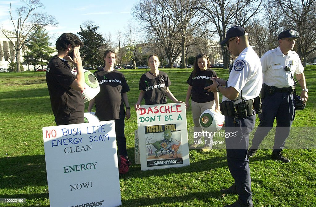 Greenpeace protestors wore 'eyes' on their heads, in criticism of Daschle's energy plan. The demonstrators called Daschle's plan 'Bush-lite.'