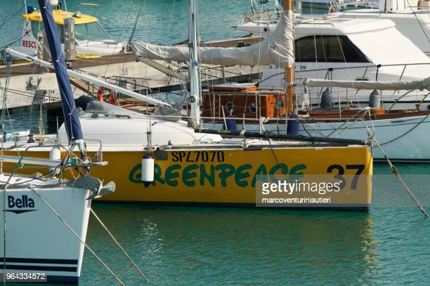 Greenpeace sailing boat moored in the port