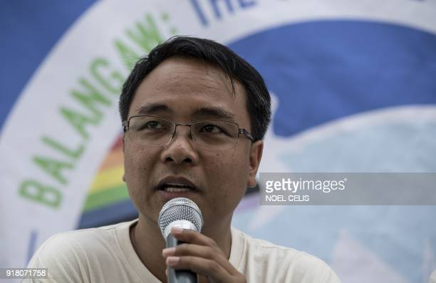 Greenpeace Southeast Asia executive director Naderev Sano answers questions during a press conference while on board Greenpeace's iconic Rainbow...