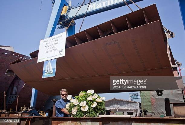 Greenpeace's Captain Peter Willox lays a wreath in memory of crewman Fernando Pereira in Gdansk on July 10 2010 who died when French agents sank the...