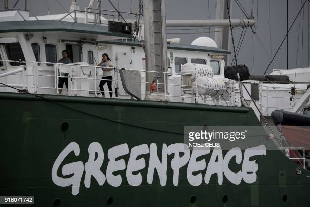 Greenpeace's iconic Rainbow Warrior sits anchored in Manila Bay during a visit on February 14 2018 The Rainbow Warrior arrived in the Philippines to...