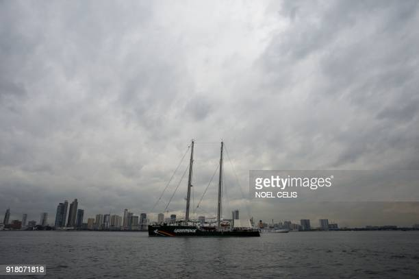 TOPSHOT Greenpeace's iconic Rainbow Warrior sits anchored in Manila Bay during a visit on February 14 2018 The Rainbow Warrior arrived in the...