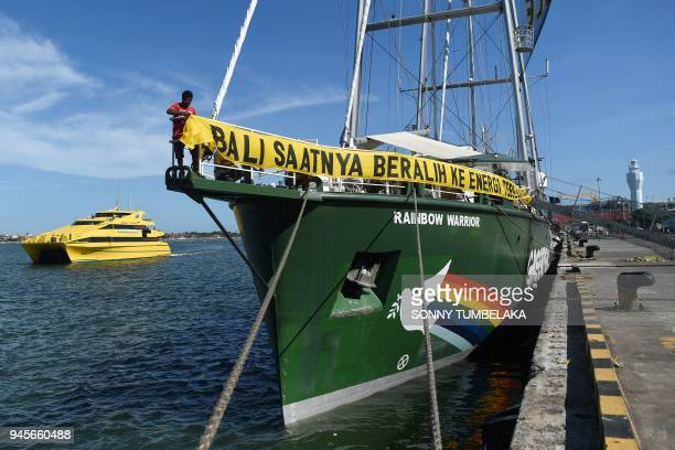 Greenpeace's Rainbow Warrior campaign ship sits docked after its arrival for a stay at Benoa port in Denpasar on Indonesia's resort island of Bali on...
