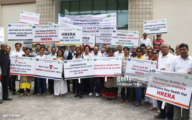 Greenpolis buyers shout slogans during protest in front of Haryana Real Estate Regulatory Authority office at Court Road on July 12 2018 in Gurugram...