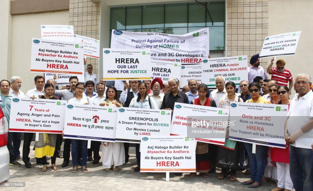 Greenpolis buyers shout slogans during protest in front of Haryana Real Estate Regulatory Authority (HARERA) office, at Court Road, on July 12, 2018 in Gurugram, India. Spread over 47 acres, the project has missed it 2015 deadline. The buyers allege that even after paying 90 percent of the amount they have still not get possession of the flats. The project has 2,317 housing units.