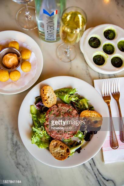 The steak tartare entree and escargo appetizer at Demarchelier Cafe and Bar in Greenport, New York on November 29, 2020. .
