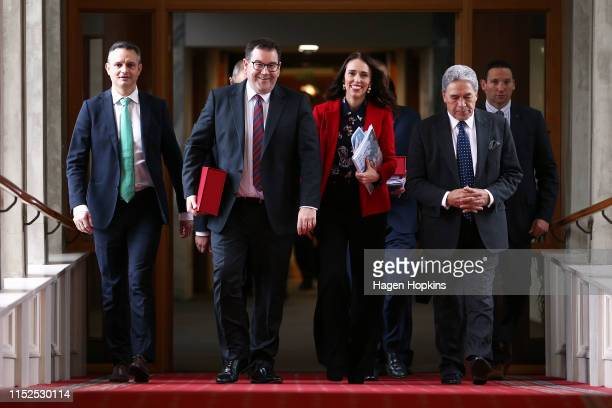 Greens leader James Shaw, Finance Minister Grant Robertson, Prime Minister Jacinda Ardern and Deputy Prime Minister Winston Peters walk to the house...