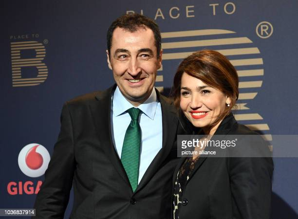 Green's party head Cem Özdemir and wife Pia Maria Castro arriving at the Berlinale party 'PlacetoB' in Borchardt during the 67th International Berlin...