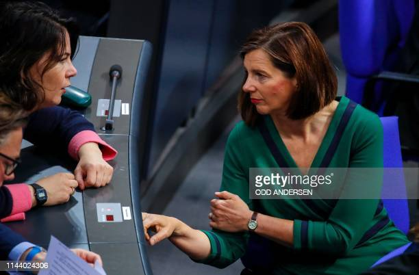 Greens party parliamentary group leader Katrin GoeringEckardt talks with the coleader of the German environmental Green party Annalena Baerbock...