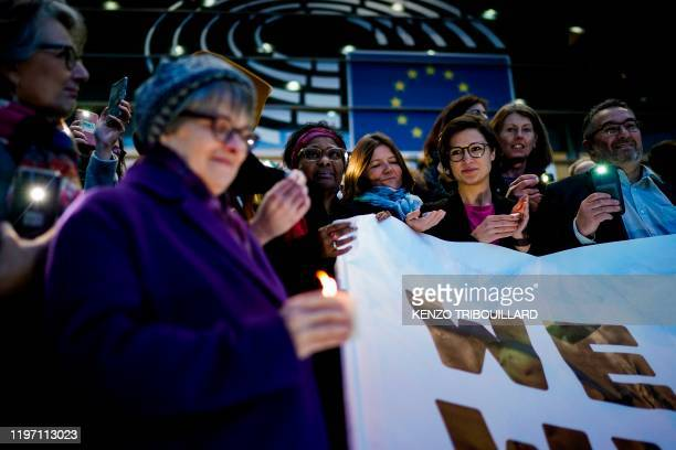 Greens/EFA party members of European Parliament holds candles as they take part in a symbolic action to mark the departure of the United Kingdom from...
