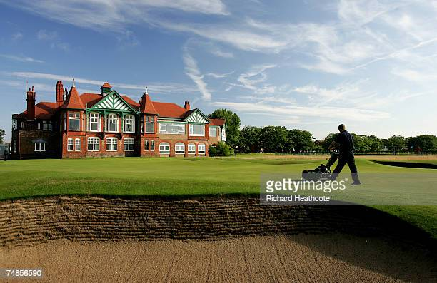 A greenskeeper cuts the 18th green before the start of the quarter final matches at The Amateur Championship 2007 at Royal Lytham St Annes on June 22...